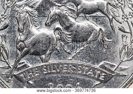 American Quarter coin close up shot with Nevada symbol