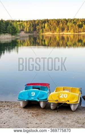 Colorful Paddle Boats On Sandy Beach By One Of The Blue Lakes, Ukraine
