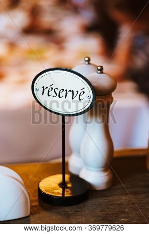 Reserve Plate With In A Cafe Or Restaurant. High Quality Photo.