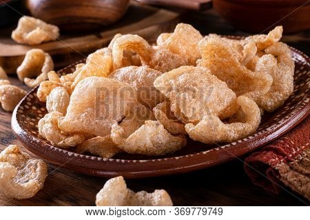 A Plate Of Delicious Deep Fried Pork Rind Chicharrones.