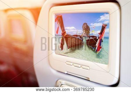 Aircraft Monitor In Front Of Passenger Seat Showing Thai Boats And Landmark At Po-da Island, Krabi P