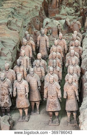 Xian, China - May 1, 2010: Terracotta Army Excavation Site. Beige-gray Group Of Statues Of Soldiers