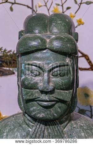 Xian, China - May 1, 2010: Terracotta Army Museum. Closeup Of Green Marble Sculpture Of Officer Face