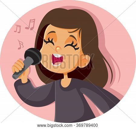 Little Girl Singing With Microphone In Her Hand