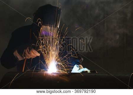 Welder Industrial Automotive Part In Factory, Industrial Worker At The Factory Welding Closeup