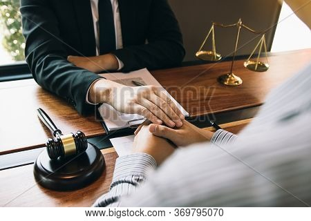 Lawyer And The Court Are Using Their Hands To Console The Client Who Is Aware That They Will Not Win