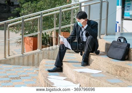 Asian Failure Unemployed Businessman Stress Sitting On Stair And Lose Job., Concept Of Business Fail