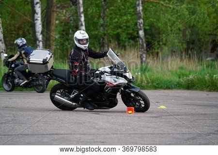 25-05-2020 Riga, Latvia. Motorcyclist Goes On Road. A Motorcyclist Learns To Control A Motorbike.
