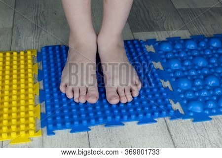 Orthopedic Foot Mat For Child Gymnastic. Small Children With A Flat-bottomed Stomach Goes Barefoot O