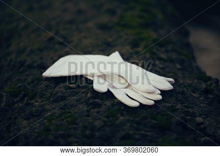 Two White Silk Gloves On The Dark Stone.