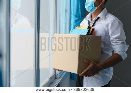 Asian Unemployed Person Holds The Document Box By The Window In Hope, Unemployment In The Covid Viru