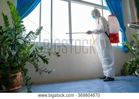 Concept Good Hygienic Care In The House,man In Hazmat Ppe Protective Clothing Wearing Protective Mas