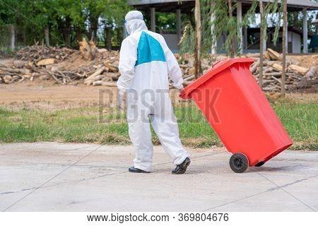 Stop Biohazard,garbage Men In Coronavirus Hazmats Working Together On Emptying Dustbins For Trash Re