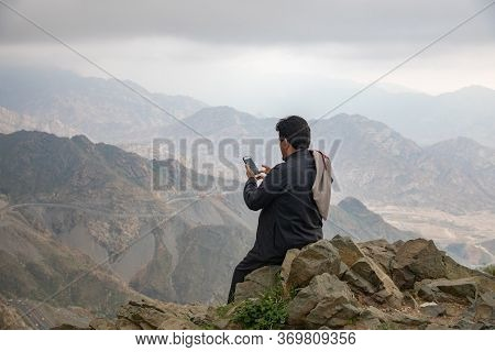 Saudi Man Watching The Beauty Of Nature In The Mountains Of Al-hada Taif, Saudi Arabia 2019
