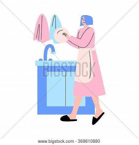 Young Smiling Woman Washing Dishes In Kitchen At Home On Weekday