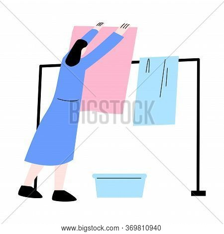 Young Woman Hanging Clean Colorful Linens On Weekday