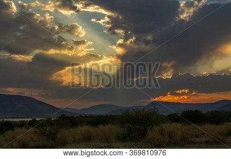 Sunset With Mankwe Dam In The Background In The Pilanesberg National Park