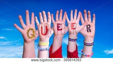 Children Hands Building Word Queer, Blue Sky