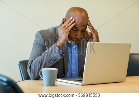 African American Man Having A Difficult Time At Work.