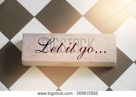 Let It Go Wooden Sign With A Chess On Background. Phylosophy Forgiveness Concept