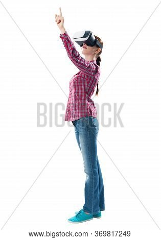 Lady In Checkered Shirt And Jeans Using Virtual Reality Glasses. Woman Wearing Vr Goggles And Intera