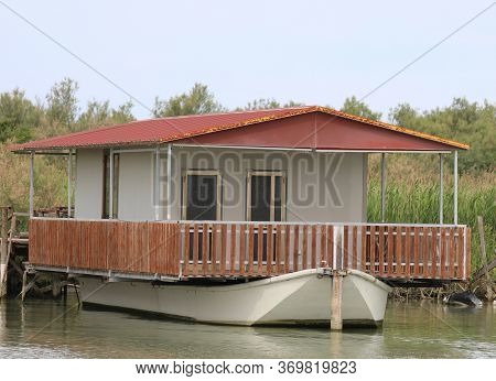Houseboat Floating On Water Of The River