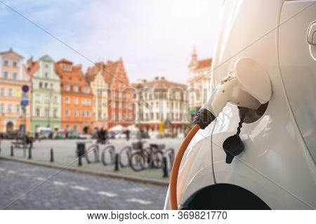 Close Up Of Electric Car With A Connected Charging Cable