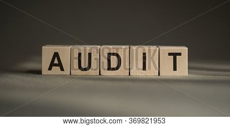 Audit Word Written On Wood Block. Audit Text On Table, Finance And Business Concept.