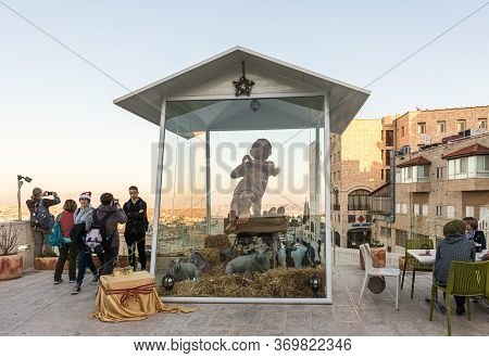 Jerusalem, Israel, December 28, 2018 : Large Wooden Doll In The Form Of A Newborn Son Of God Behind