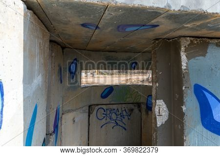 View Of The Border Dividing Strip Through The Embrasure In The Concrete Security Separation Fence On