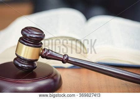 Book, Judges Gavel, Criminal Codex On The Judges Table. Concept Of Law And Order. Table Of The Judge