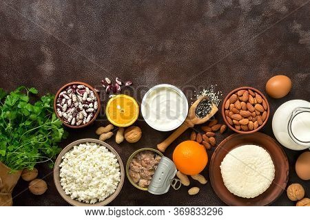 High Calcium Food. A Variety Of Products Rich In Calcium On A Dark Rustic Background. Top View, Flat
