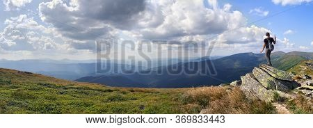 Young Hiker Man Standing On Top Of Cliff Taking A Selfie On Background Mountain Range Of Chernogor I