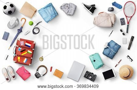 Recreation Concept. Suitcase With Clothes And Accessories For Traveling And Tourism On A White Backg