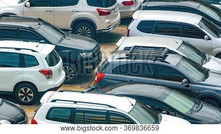 White And Black Car Parked At Concrete Parking Lot Of Shopping Mall In Holiday. Aerial View Of Outdo