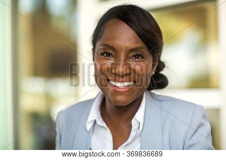 Portrait Of A Mature Healthy Older Woman Happy And Smiling.