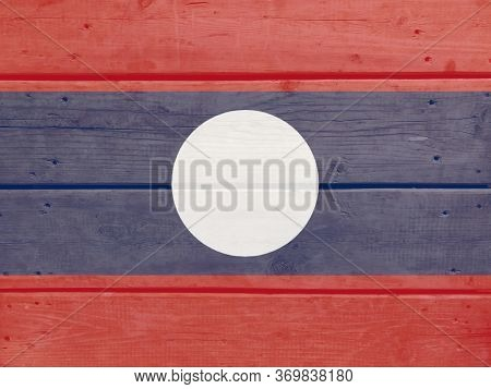 Lao P.d.r. Flag Painted On Wood Plank Background. Brushed Natural Light Knotted Wooden Board Texture