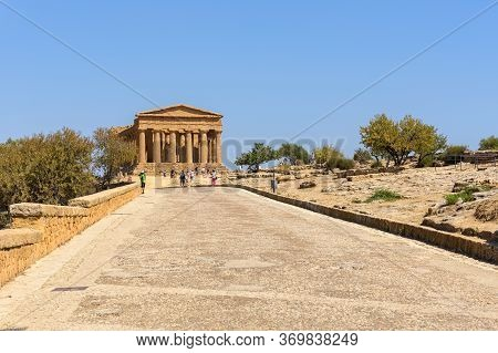 Agrigento, Sicily, Italy - August 24, 2017: Tourists Visit Ruins Of The Temple Of Concordia In The V