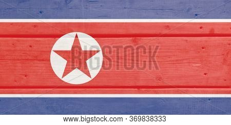 Korea, D.p.r. Flag Painted On Wood Plank Background. Brushed Natural Light Knotted Wooden Board Text