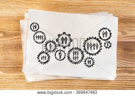 Corporate Social Responsibility Concept With Group Of Rotating Gears And Cogs. Human Resources Coope