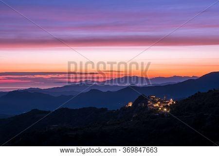 Dawn Breaking Over Speloncato And Coastline Of Corsica