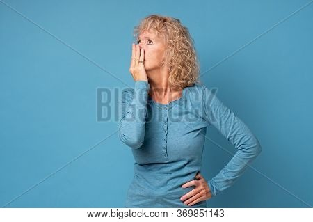 Scared Middle Aged Senior Woman Covering Mouth With Hands Feel Horrified