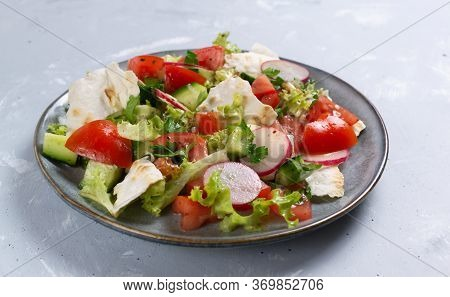 Vegan Fattoush Salad In A Gray Plate On A Gray Background. Close Up. Levantine Salad Fattoush, Which