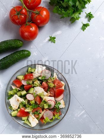 Fattoush Salad In A Gray Plate With Ingredients On A Gray Background. Top View. Vertical Orientation