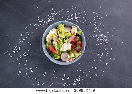 Fattoush Vegetarian Salad In A Gray Bowl Against Black Background. Top View. Levantine Salad Fattous