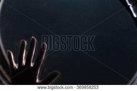 Hand Of Astronaut Looking To Space. Elements Of This Image Furnished By Nasa