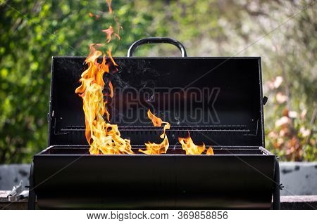 Man Heats The Bbq Grill, Preparing For Grilling Some Kinds Of Meat, Bbq Concept
