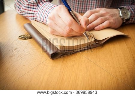 Pen In A Hand. Going To Write Something Down. Watch On A Hand.