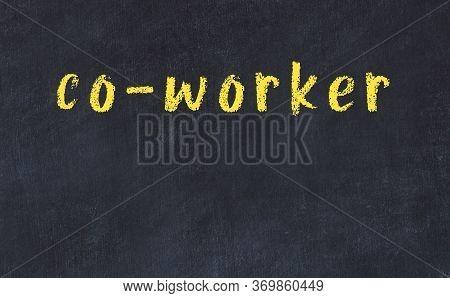 Chalk Handwritten Inscription Co-worker On Black Desk