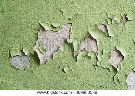 Close Up Of Old Stucco Cracks On The Wall. Weathered Paint Cracks On Plaster. Cracked Wall Backgroun